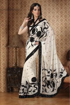 Come feel the rhythm of fashion. Be center of attraction in this latest buttery off white faux georgette saree. having beautiful work in lovely pattern. This lovely piece is looking extra beautiful with embellishment of resham, sequins and patch work.