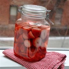 Make your own Strawberry Flavored Vodka.     What you will need:   One bottle (750ml) vodka   2 pints (about 1 1 /4 pounds, 575g) strawberries   Jar with a lid     Instructions:     1. Rinse, hull, and quarter the strawberries and place them in a glass container with lid. Add vodka, cover, and agitate the jar.   2. Store in cool, dark place (such as a kitchen cabinet) for 3 to 7 days, swirl around once a day.   3. After 3 to 7 days, strain with a coffee filter.   4. Store in a bottle.