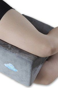 This very important knee pillow for the side-sleeping boss. | 31 Ingenious Products You Need For Better Sleeping