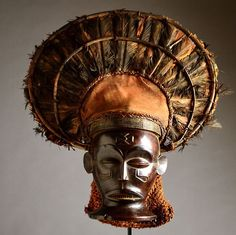 Africa | Chihongo mask from the Chokwe people of Angola or DR Congo | Wood, feathers, raffia, cloth | Mid to late 20th century