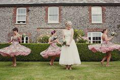 Twirling bridesmaids