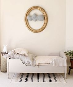 neutral kids room, cloud in frame