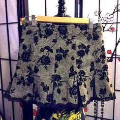 Betsey Johnson Tweed & Velvet Floral Mini Skirt Tweed mini skirt with velvet burnout flowers and lace inserts so it flares. Really cute and hard to find. One of her vintage retro pieces.    I offer 20% off on bundles is 2 or more. Limited time get a FREE $10 Ulta Gift Card with every bundle worth $25+. Offer is first come first serve until they run out. Betsey Johnson Skirts Mini