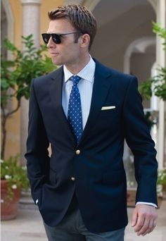 Shop this look for $157: http://lookastic.com/men/looks/blazer-and-dress-shirt-and-tie-and-pocket-square-and-dress-pants/236 — Navy Blazer — White Vertical Striped Dress Shirt — Blue Tie — White Pocket Square — Grey Dress Pants