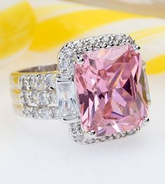 Pop on over for some candy-colored goodness and enjoy the sweet indulgence of this calorie free bubble gum pink ring! It's the icing your outfit needs! | 17.76ctw Pink & White Diamond Simulant Rhodium Plated Sterling Silver Ring [Promotional Pin]