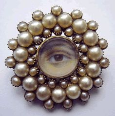 Georgian eye brooch in a gold and pearl frame, circa 1800,