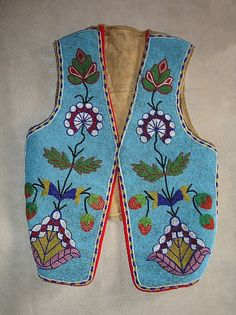 "Cree beaded vest. This vest was a gift to a ""Adelphine Chaloux from the one loves her"" 'Jaquima' Don Gregorio-Bonacina, Bronc and Steer Rider, Peace River, British Colombia, Canada"" as written on the inside lapel. Fantastic floral and strawberry beadwork on the front, and hand painted (by Don Bonacina) steer and rider along with his brand and signature. Circa 1910."