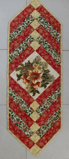 Christmas patchwork tablerunner. Traditional green red and cream, holly, poinsettias. Xmas handmade quilted table runner