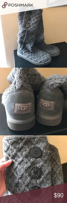 Used Gray Cable Sweater Uggs. Size 10 Beautiful Grey Cable Sweater Uggs. Size 10. Bottom 2 buttons on top of left boot the wood is showing through. Other than that they are in good condition. They hit right below knee. UGG Shoes Winter & Rain Boots