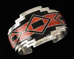 Sterling silver, coral and black jet rug pattern inlay bracelet by Phil Secetaro, Navajo
