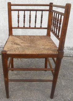 An Arts and Crafts corner chair. Dissimilar form the William Morris example as it has a single rail above the spindle panel. View 1.