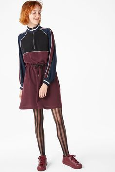 <p>You'll be an all-star in this fun sporty dress. You've got all the retro charm with side-stripe arms, a zippy 3/4 polo neck and a colour-block palette. H