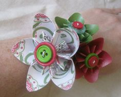 I just learned how to make these paper flowers- and now with buttons!!!