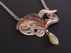 """Passion Made Visible - Pendant of Russian filigree and high relief Eastern repoussé from straight grain mokume gane, suspended from a Roman chain  fine silver, sterling, copper, shibuichi, 22k gold, Koroit opal 2-1/2"""" x 3"""" x 3/8"""",, chain 18"""" © 2011, V. Lansford $1980."""