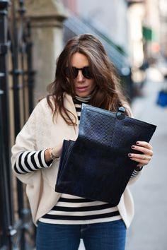 Stripes, sweater, clutch.