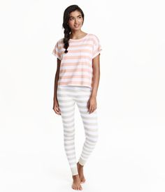 Striped pajamas in soft, melange cotton jersey. Short T-shirt with chest pocket. Leggings with elasticized drawstring waistband and ribbed hems.