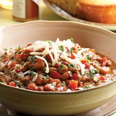 This Beef and Bean Chili Verde dish is packed with ground beef, sweet bell peppers, and a spicy kick from chili powder and cayenne pepper. #healthyeating #chilirecipes #healthyrecipes #everydayhealth | everydayhealth.com