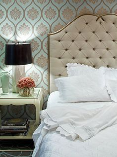 beautiful palette. love the harmony of all the scallops in the headboard, wallpaper, bedside table and shams. and i always love a black shade.