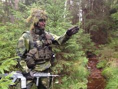 Swedish soldier spots an insurgent moose. Military Gear, Military Weapons, Action Poses, Insurgent, Warfare, Camouflage, Warriors, The Unit, Soldiers