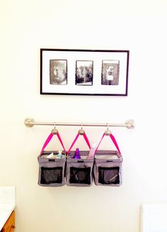Thirty-One Little Carryall Organizer in the bathroom with shower hooks on a towel rod to organize small things