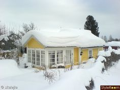 Pretty yellow house in the snow