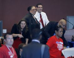 Karen Lewis, president of the Chicago teachers union , left, and vice president Jesse Sharkey stand before a meeting of the union's House of Delegates Friday, Sept. 14, 2012, in Chicago.