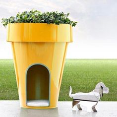 #ad De Castelli - Dog-E Dog's House Vase and comfortable basket for your dog. A fun and appealing idea for combining forms of animal and plant life both in the home and garden. The upper part is made to hold a plant or to store the dogs accessories (collar, leash, etc.) and features a lid to close it. dog-e is completed by a pillow in fabric or leather.   $2,045.76 at 2modern Furniture for the Home and Office   FREE SHIPPING