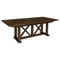 Mission-style oak wood dining table with a trestle base and two eighteen-inch leaves.  Product: Dining tableConstruc...