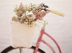 Vintage bicycle with basket of flowers...