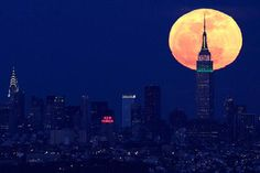 full moon behind the Empire State Building in New York... view from Eagle Rock Reservation in West Orange, N.J.