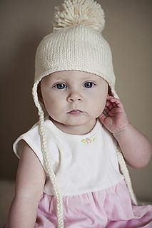Simple earflap hat knit from the top down means there is no seaming or picking up stitches. Braided ties allow this hat to tie on making it very functional for your busy little one. Ad an optional pom-pom for extra fun.