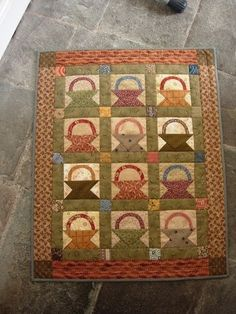 I thought many of you would enjoy seeing some of the little baskets quilts that quilters in my Yahoo group Small Quilt Talk made for my One...