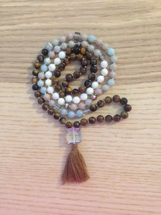 A personal favorite from my Etsy shop https://www.etsy.com/listing/274098322/handmade-108-knotted-mala-beads-tigers