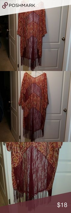 """XL/XXL Xhilararion Boho Fringe and Lace Kimono. XL/XXL Xhilararion Fringe and Lace Kimono Duster. Lace detailing. Paisley printed fabric. Fringe trim along the bottoms. Sheer fabric in shades of maroon and gold gives this a boho feel. Approximately 58"""" long. This Xhilararion fringe and lace kimono duster is an absolute must for concerts, festivals and any event by the water.  Excellent condition, smoke free, one cat home. Xhilaration Sweaters Cardigans"""