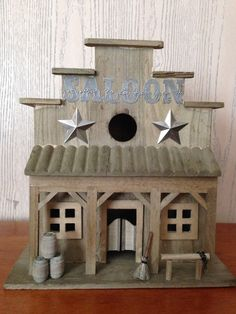 Rustic and primitive saloon birdhouse.