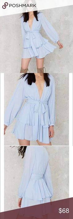 Blue Deep V Neck Ruffle Dress Small Light Blue Chiffon and features a plunging neckline, elastic waist, ruffle skirt, and detached robe belt, partially lined. Polyester, try to size, model wearing a small, machine wash cold. Length: 34 in. Haoduoyi label. Nasty Gal Dresses Long Sleeve