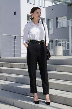 White shirt, black trousers, gold details