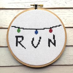 "This cross stitch DIY KIT features ""RUN"" with holiday string lights. This design is inspired by the TV show Stranger Things This piece once you sew will measure about 3"" x 5"". Skill Level: Beginner Ki"