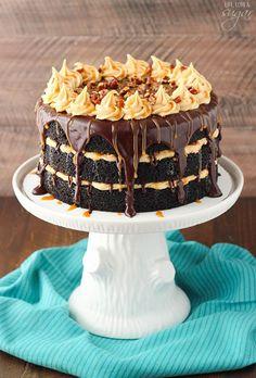Turtle Chocolate Layer Cake! Layers of moist chocolate cake, caramel icing, chocolate ganache and pecans! So good!