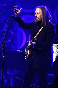 Tom Petty Photos - Tom Petty performs onstage during the Songwriters Hall Of Fame 47th Annual Induction And Awards at Marriott Marquis Hotel on June 9, 2016 in New York City. - Songwriters Hall Of Fame 47th Annual Induction And Awards - Show