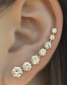 Jewel ear cuff - only requires one piercing and there is a wire that hugs your ear on the back and holds the ear pin in place.