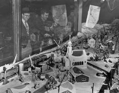 Train layouts were big draws during the glory days of Lionel and American Flyer, then the two most popular lines of toy electric trains. The stores reserved corner windows to allow for dramatic scenes of trains rushing out of tunnels, over bridges and through snow-covered towns. This is a view of Famous-Barr's five-level train layout in 1952. The store, now Macy's, still has a Christmas train display in the corner window at Seventh and Locust streets. [Post-Dispatch)