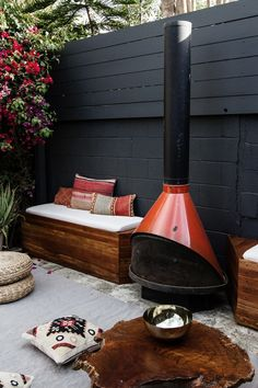 Patio Lounge built in benches with a Red Enamel 1960s Freestanding Fireplace by Smitten Studio | Gardenista