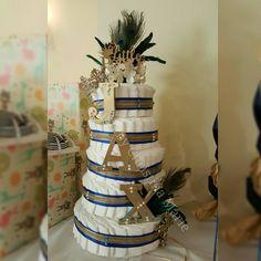 NEW Diaper Cake made for a royal themed baby shower! #royal #littleprince #babyshower #diapercake #gold #royalblue #swarovski #crystals #pearls #themedbabyshower #jax #babyboy #custommade #peacock #custom #fivetier #ribbon #crown #addictionbychristinamarie