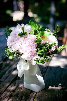 This bridal bouquet is lush with greenery and full pink peonies-gorgeous for a rustic-chic outdoor wedding.