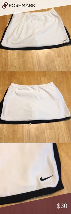 Nike Dri-Fit Skirt A white Nike Fri-Fit skirt that has built in shorts. Size Medium (8-10). Great for an active woman. Worn only a couple times. Smoke free home. Nike Skirts