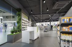 Pharmacie De Courrèges – Cancale | Agence UH Plant Wall, Pharmacy, Architecture Design, Drywall, Pet Shop, Interior Ideas, California, Display, Shopping