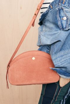 035d8703ea3 madewell dakota shoulder bag worn with the oversized jean jacket.