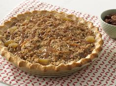 Bisquick® mix makes it simple creating an easy, press-in-the-pan one-crust pie dough. Unlike traditional dough, this is softer and very tender with no rolling pin required! Pecans add crunch, and caramel topping adds gooey goodness to this yummy pie.