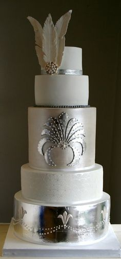 Silver and White Art Deco Wedding Cake ~ this cake was finished with edible silver leaf, stencilling and piping and sugar feathers.  ~ all edible